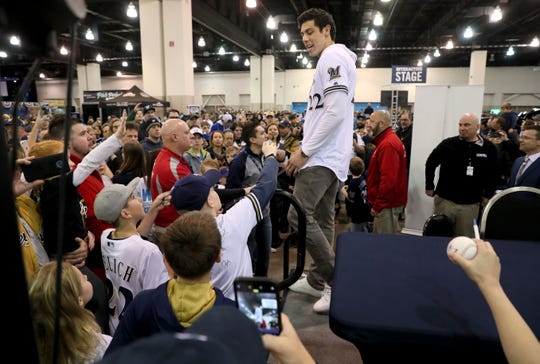 Fans young and old clamored for an autograph as the Brewers Christian Yelich leaves a radio interview at the Milwaukee Brewers annual On Deck fan event Sunday at the Wisconsin Center in downtown Milwaukee.