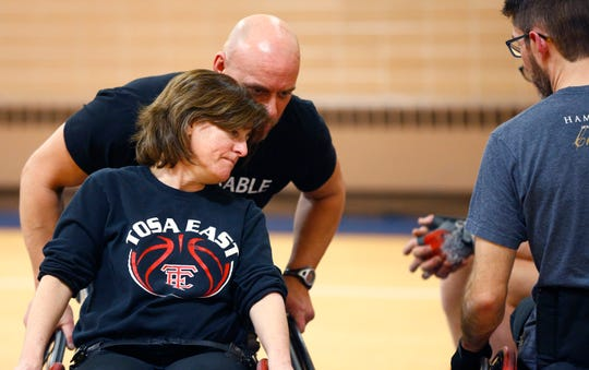 Damian Buchman gives Joan Nink a play pointer while playing in the 3 vs. 3: Adult Wheelchair Basketball League with able bodied and mobility limited players at Jefferson Elementary School in Wauwatosa on Jan. 24.