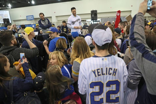 Ryan Braun is mobbed by fans and signed some autographs before a radio interview at the Milwaukee Brewers On Deck event.