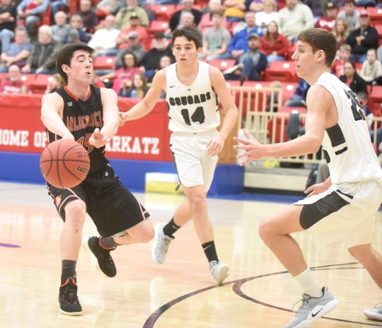 Calico Rock's Connor Sanders is defended by Izard County's Coby Everett and Caleb Faulkner on Saturday night.