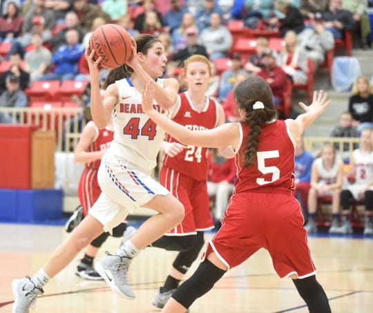 Melbourne's Kenley McCarn drives to the basket Saturday night.