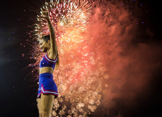 Louisiana Tech cheerleader Ari Mendiola is hoisted into the air as fireworks explode behind her after Tech's 54-17 win against Southern University at Joe Aillet Stadium in Ruston, La. on Sept. 8.