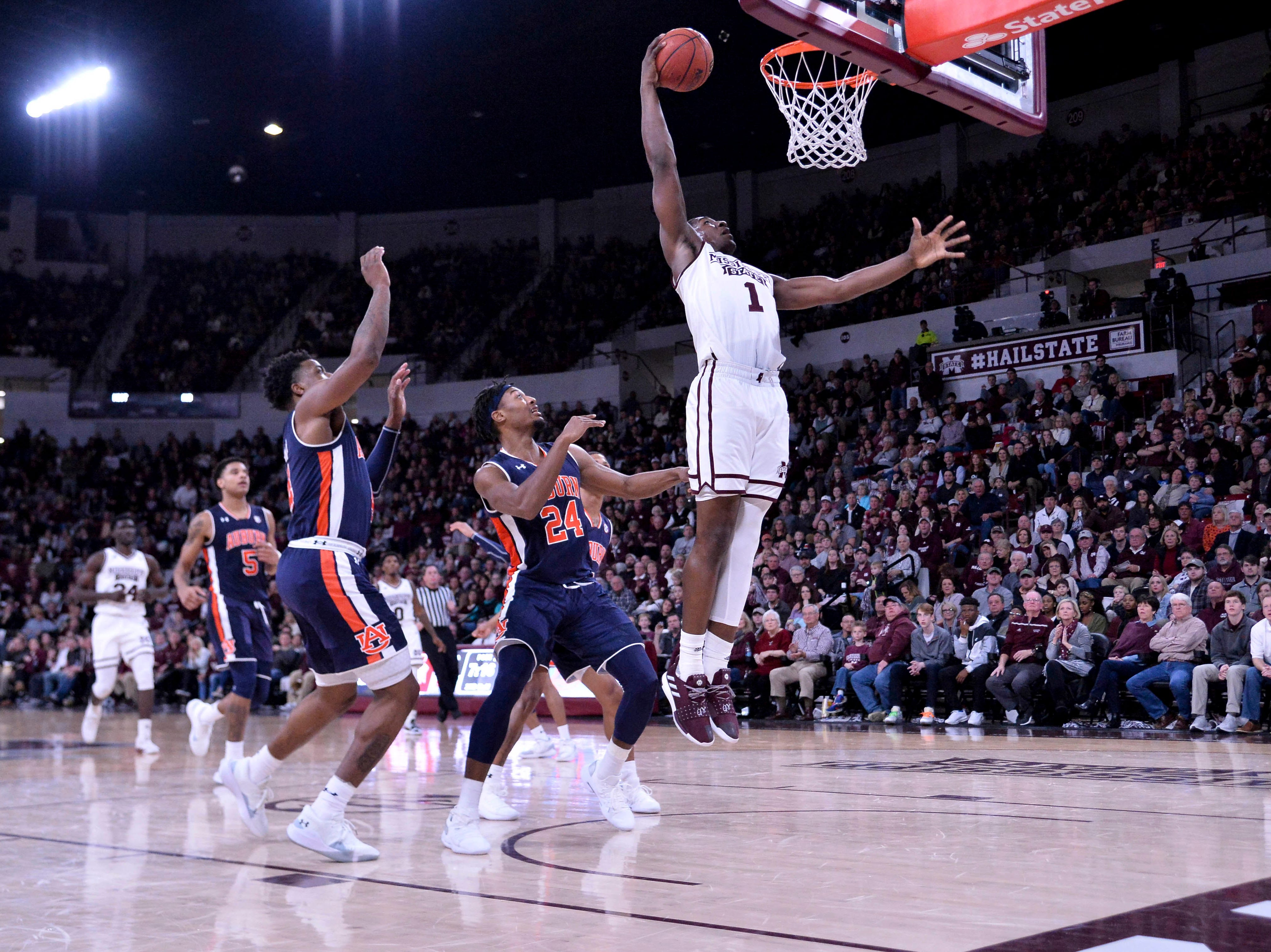 Mississippi State forward Reggie Perry (1) dunks against Auburn guard Malik Dunbar (4) and forward Anfernee McLemore (24) at Humphrey Coliseum on Jan. 26, 2019, in Starkville, Miss.