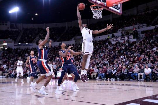 Mississippi State forward Reggie Perry (1) dunks against Auburn guard Malik Dunbar (4) and forward Anfernee McLemore (24) at Humphrey Coliseum on Jan. 26, 2019, in Starkville, Miss.