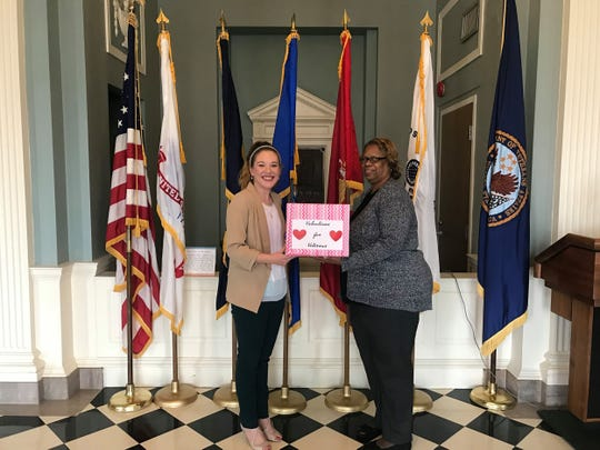 Town of Pike Road Community Involvement Coordinator Katy Garren, left,  presents 2018 Valentines to Vanessa Bullock of the veterans health care system.
