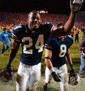 Auburn's Carnell Williams celebrates at the end of the team's 28-23 victory over Alabama, Saturday, Nov. 22, 2003, at Jordan-Hare Stadium in Auburn, Ala. Williams scored two touchdowns on 26 carries and ran for 204 yards.