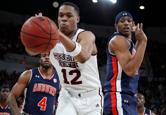 Mississippi State guard Robert Woodard (12) reaches for the ball in front of Auburn players Malik Dunbar (left) and Horace Spencer (right) on Saturday, Jan. 26, 2019, in Starkville, Miss.