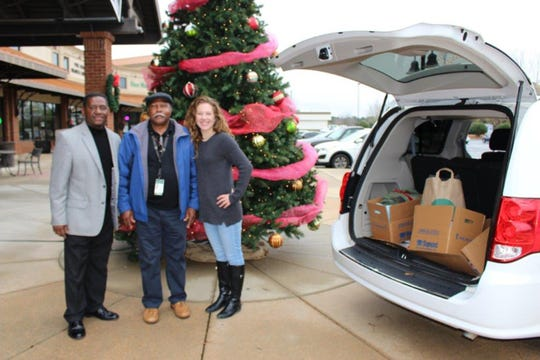 From left, Earl Hawkins and Jimmy Fannings of the veterans health care system meet with Pike Road Community Involvement Coordinator Katy Garren about 2018 holiday donations for veterans.