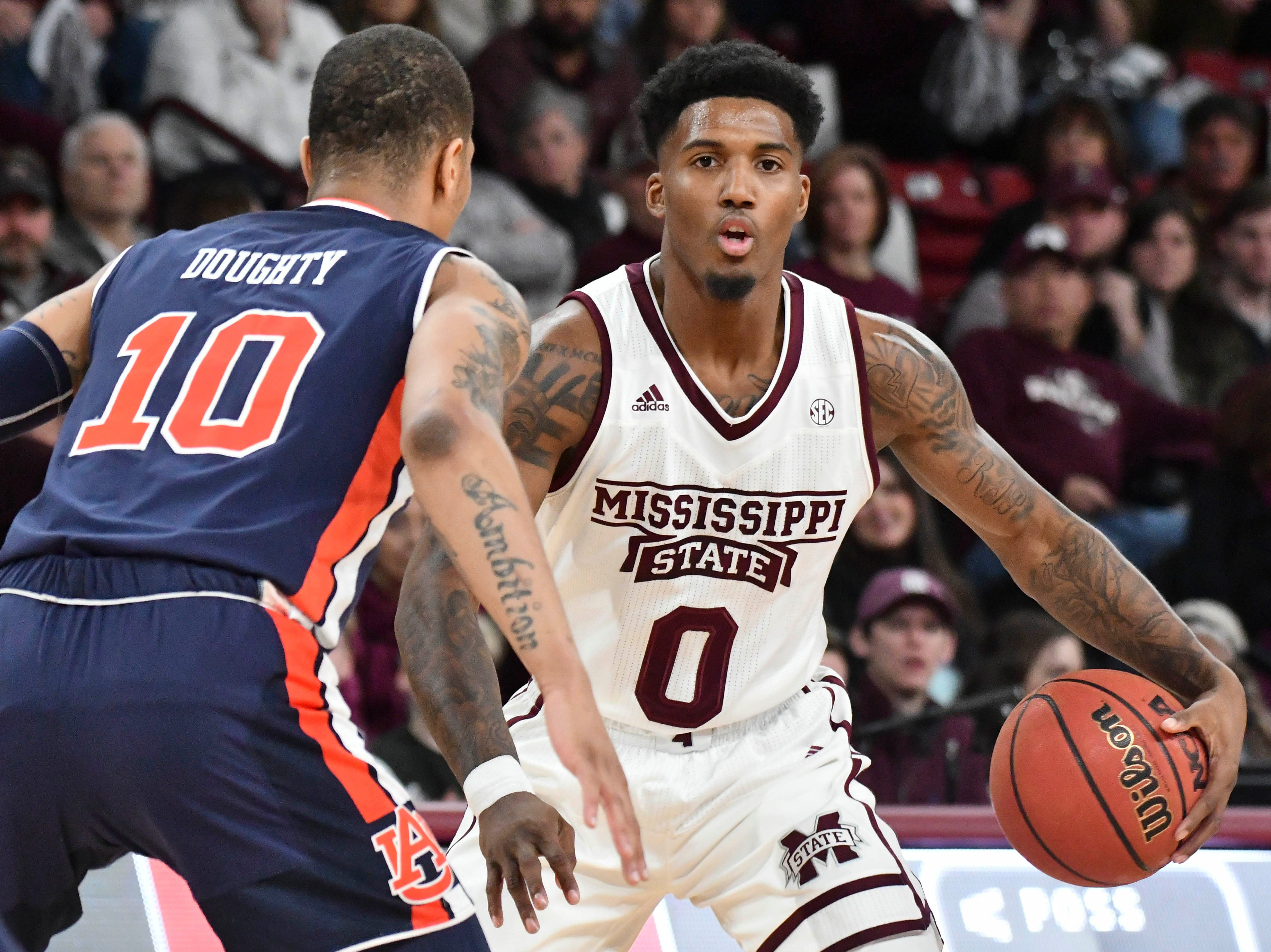 Jan 26, 2019; Starkville, MS, USA; Mississippi State Bulldogs guard Nick Weatherspoon (0) handles the ball against Auburn Tigers guard Samir Doughty (10) during the first half at Humphrey Coliseum. Mandatory Credit: Matt Bush-USA TODAY Sports