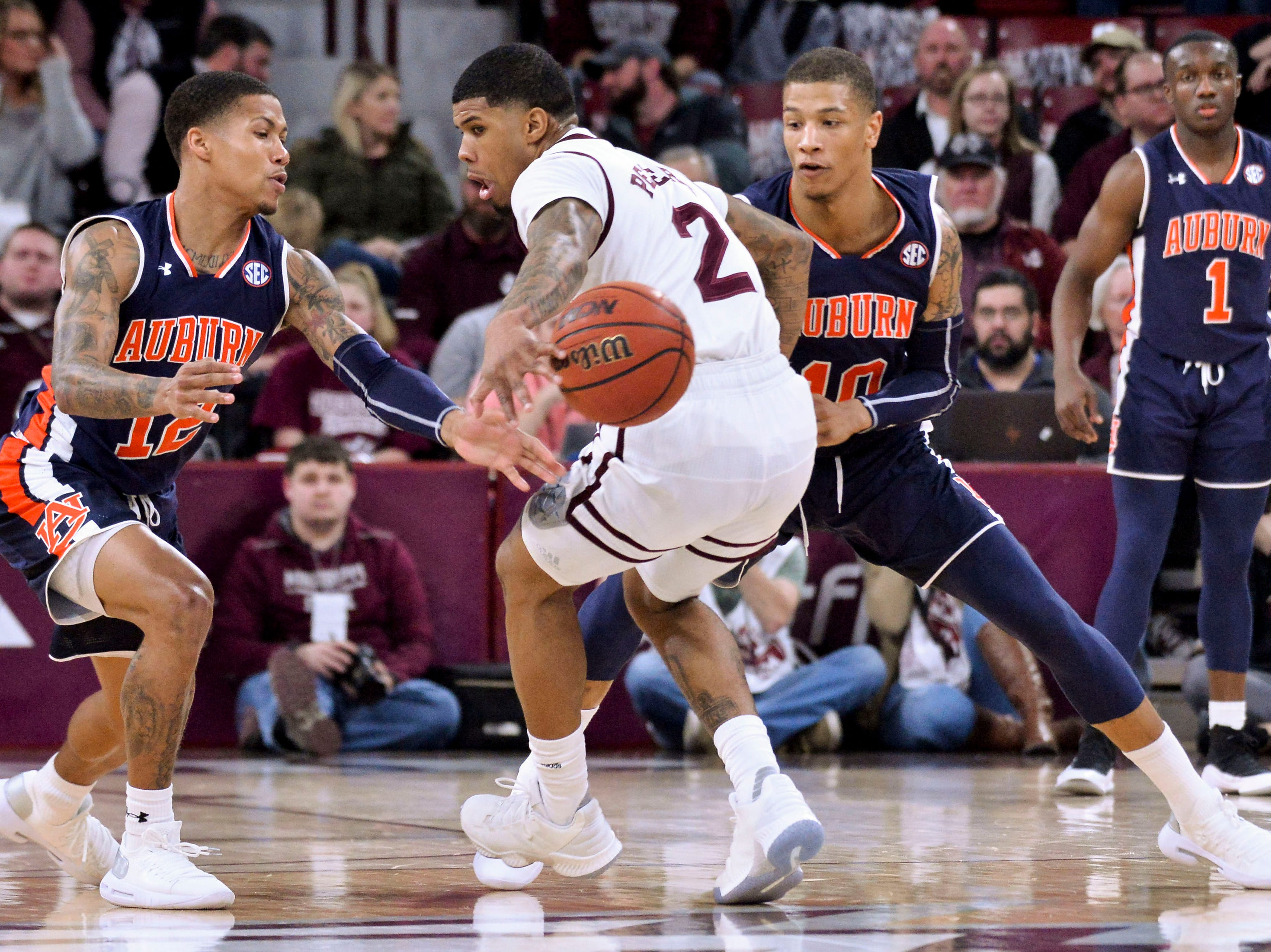 Jan 26, 2019; Starkville, MS, USA; Mississippi State Bulldogs guard Lamar Peters (2) loses control of the ball against Auburn Tigers guard J'Von McCormick (12) and guard Samir Doughty (10) during the first half at Humphrey Coliseum. Mandatory Credit: Matt Bush-USA TODAY Sports
