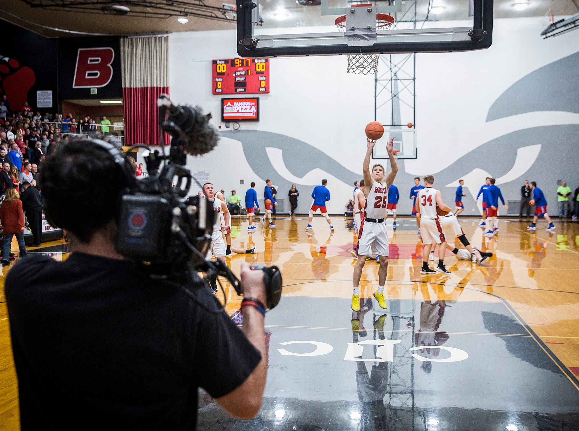 A film crew shoots a segment on Blackford for the Indiana Pacers during their game against Jay County.