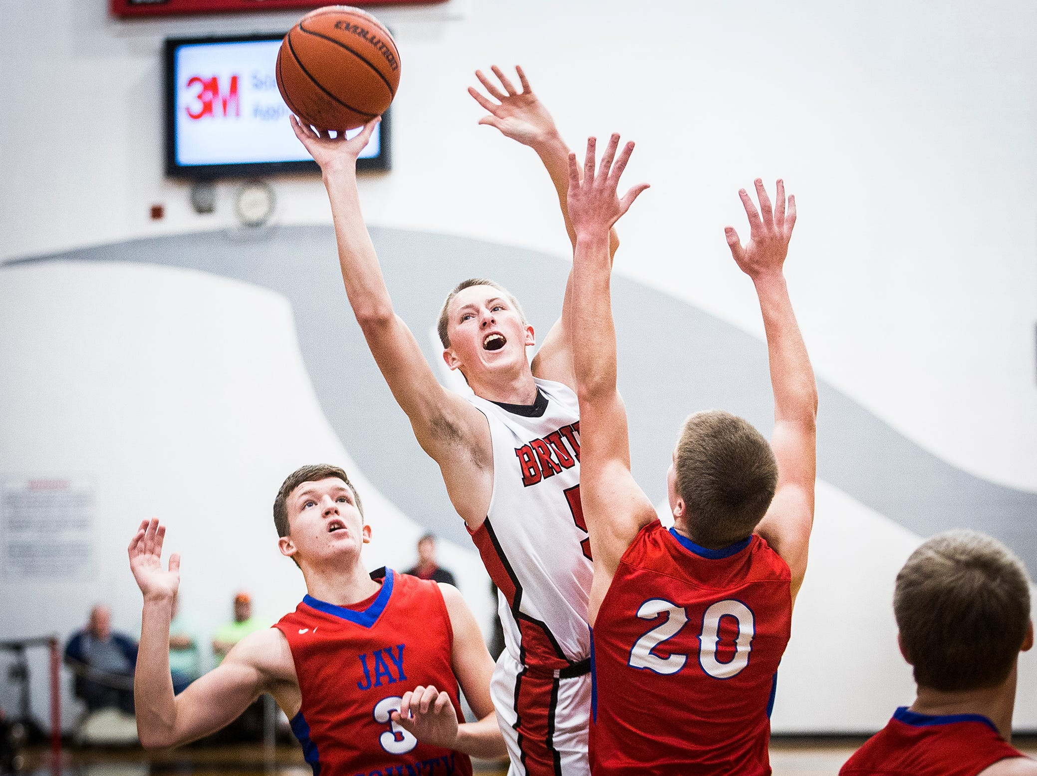 Blackford's Brandon Stroble shoots past Jay County's defense during their game at Blackford High School Saturday, Jan. 26, 2019.