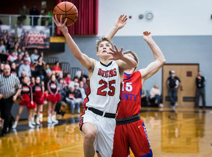 Blackford's Luke Brown shoots past Jay County's defense during their game at Blackford High School Saturday, Jan. 26, 2019.
