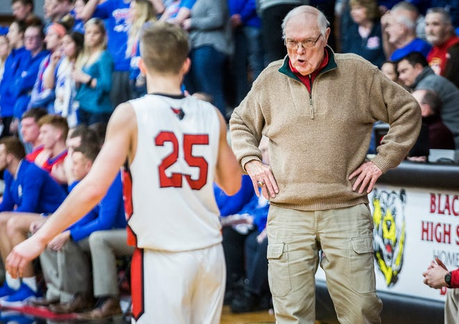 FILE -- Blackford's Jerry Hoover talks to Luke Brown during a game against Jay County at Blackford High School Saturday, Jan. 26, 2019. Hoover stepped down at the Bruins' head coach this week after three seasons.