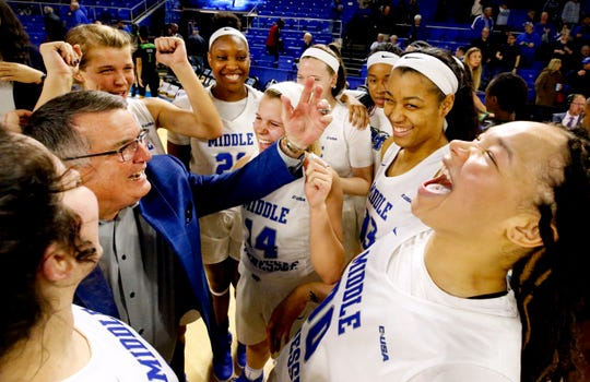 MTSU coach Rick Insell, forward Alex Johnson (00) and the rest of the Lady Raiders celebrate after beating North Texas 61-46 and making Insell the all-time winningest coach in MTSU basketball history on Jan. 26, 2019.