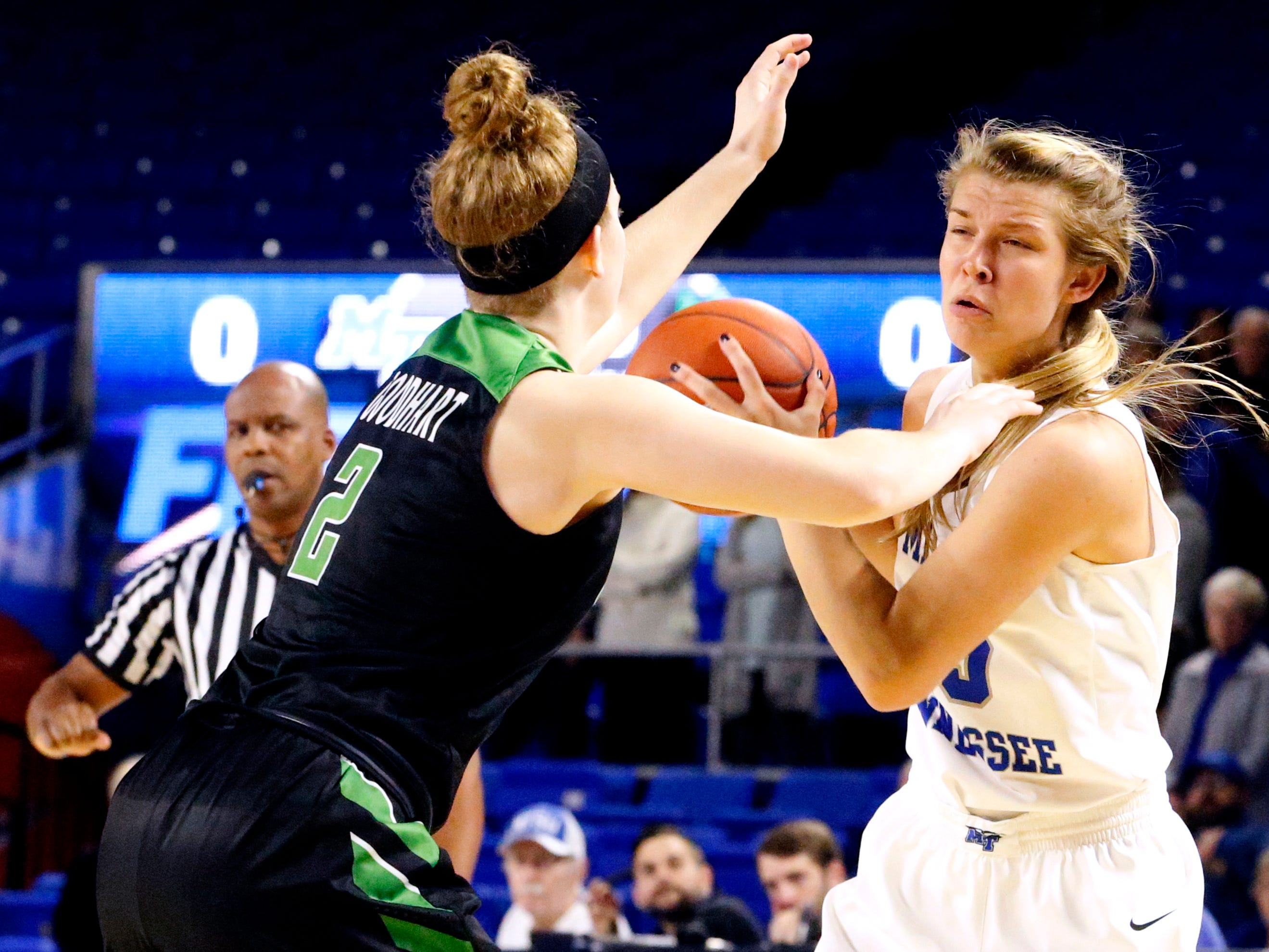 MTSU's guard Anna Jones (15) looks to pass the ball as North Texas' guard Grace Goodhart (2) guards her Saturday Jan. 26, 2019.