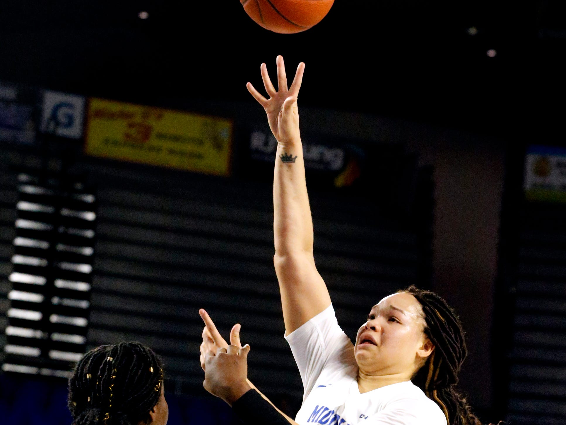 MTSU's forward Alex Johnson (00) shoots the ball as North Texas' forward/center Anisha George (42) defends her on Saturday Jan. 26, 2019.