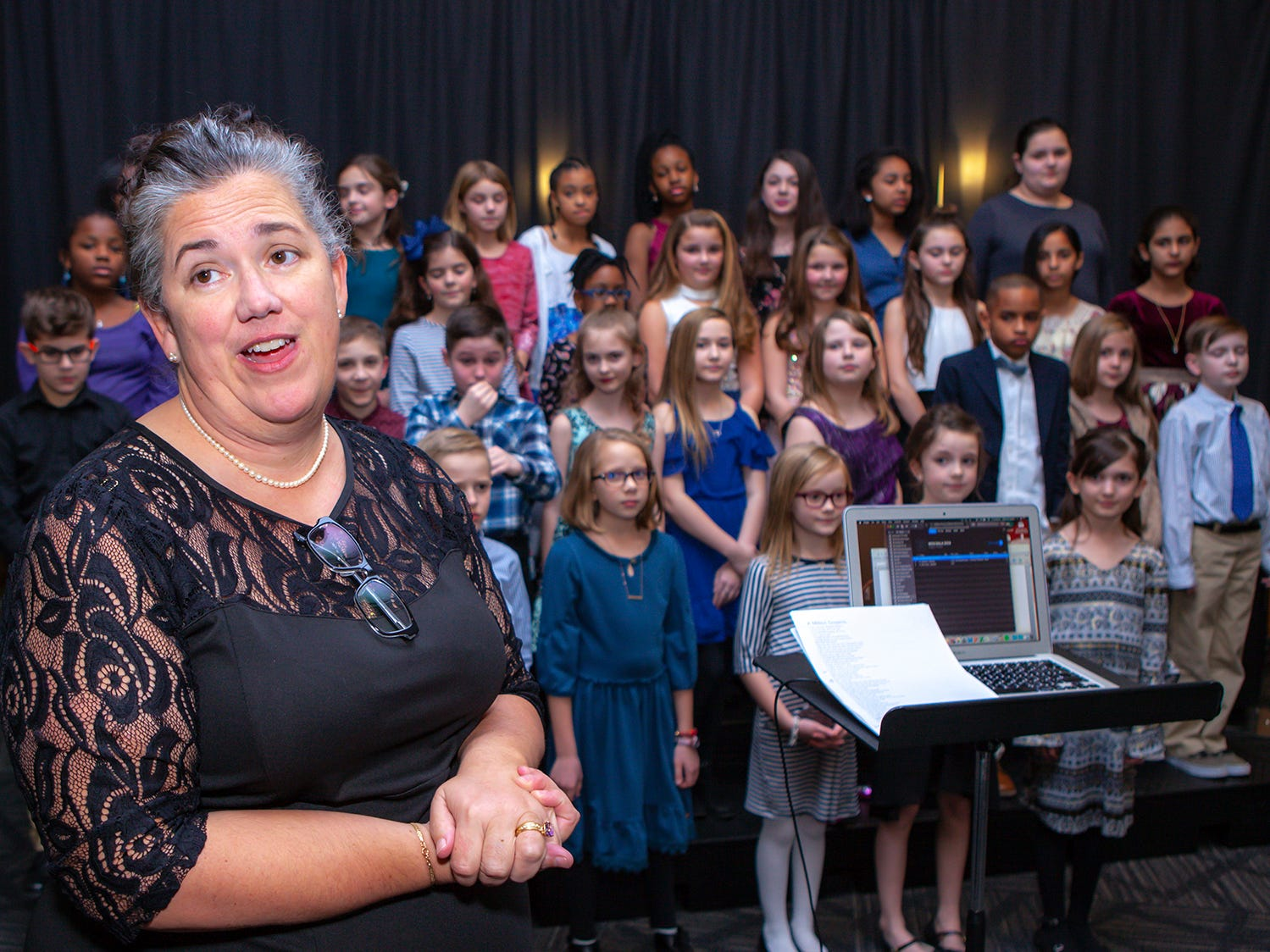 Cathrine Gordon leads the Overall Creek Elementary chorus at the 2019 Excellence in Education Gala, hosted by the City Schools Foundation on Friday, Jan. 25, 2019 at Stones River Country Club in Murfreesboro.