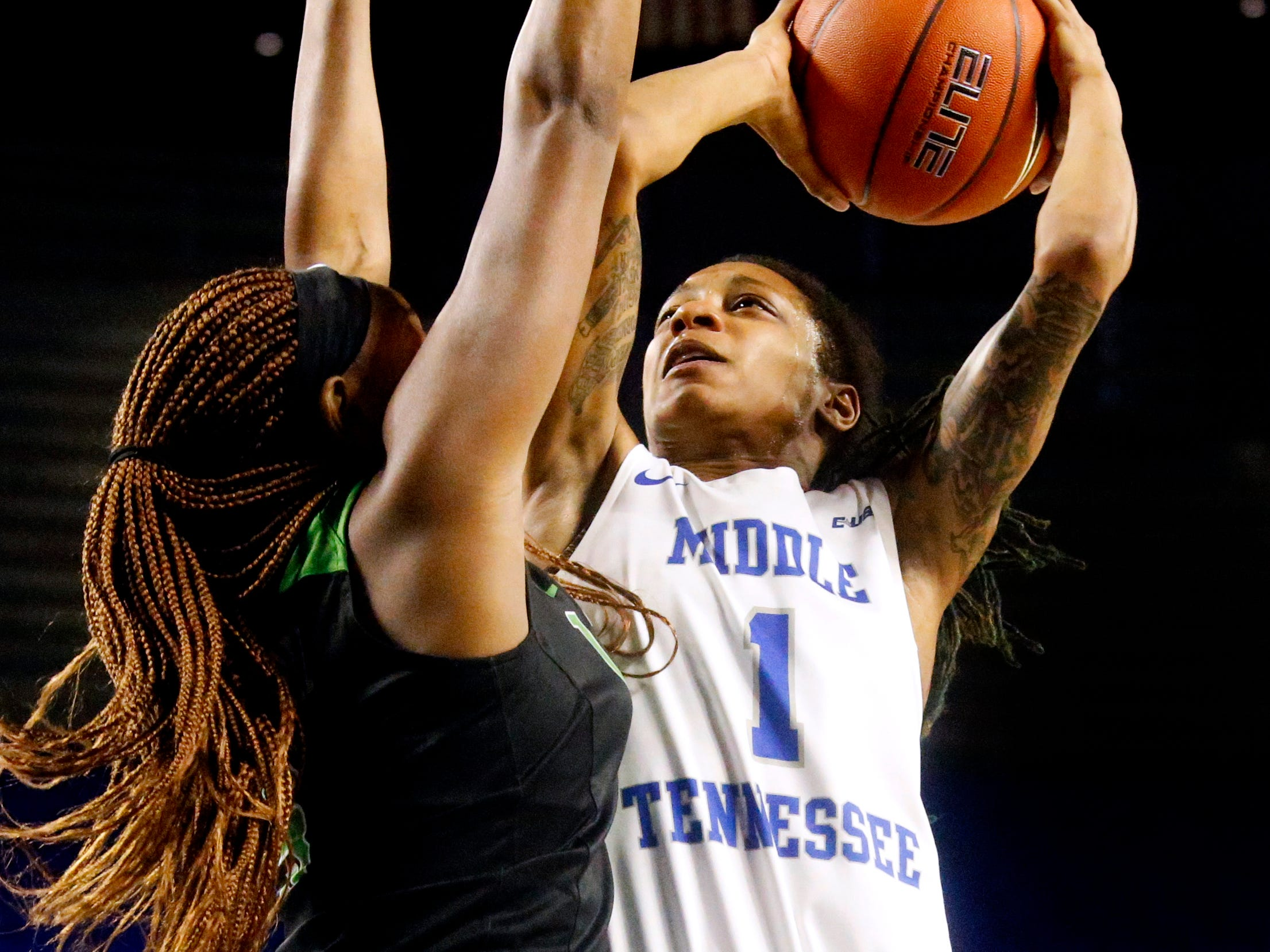 MTSU's guard A'Queen Hayes (1) shoots the ball as she I guarded by North Texas' guard Velma Mitchell (5) on Saturday Jan. 26, 2019.