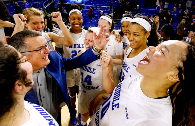 MTSU's head coach Rick Insell cheers with his team as MTSU's forward Alex Johnson (00) also celebrates after MTSU beat North Texas 61-46 and making Insell the all time winningest coach in MTSU basketball history on Saturday Jan. 26, 2019.
