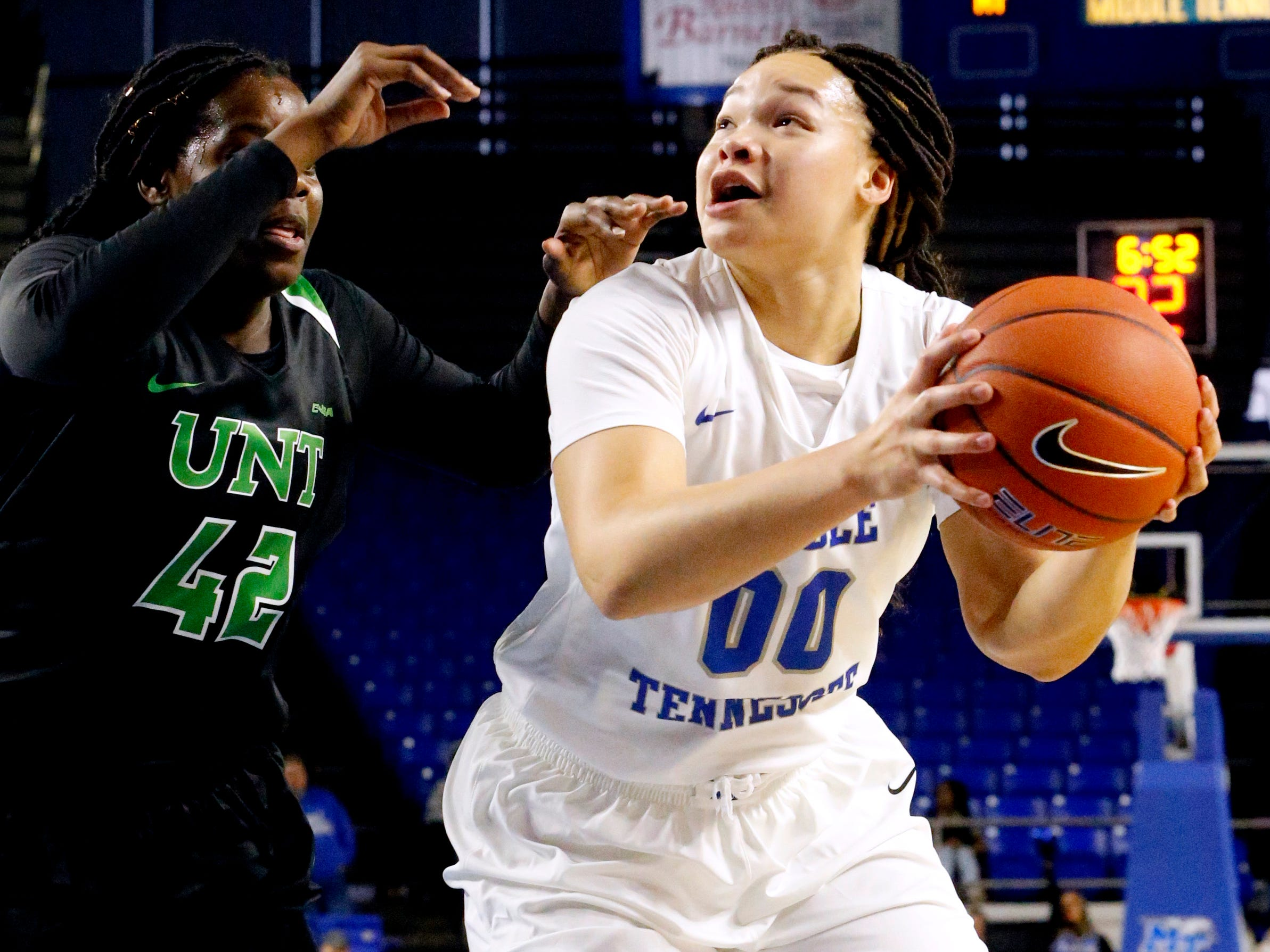 MTSU's forward Alex Johnson (00) goes looks to go up for a shot as North Texas' forward/center Anisha George (42) guards her on Saturday Jan. 26, 2019.