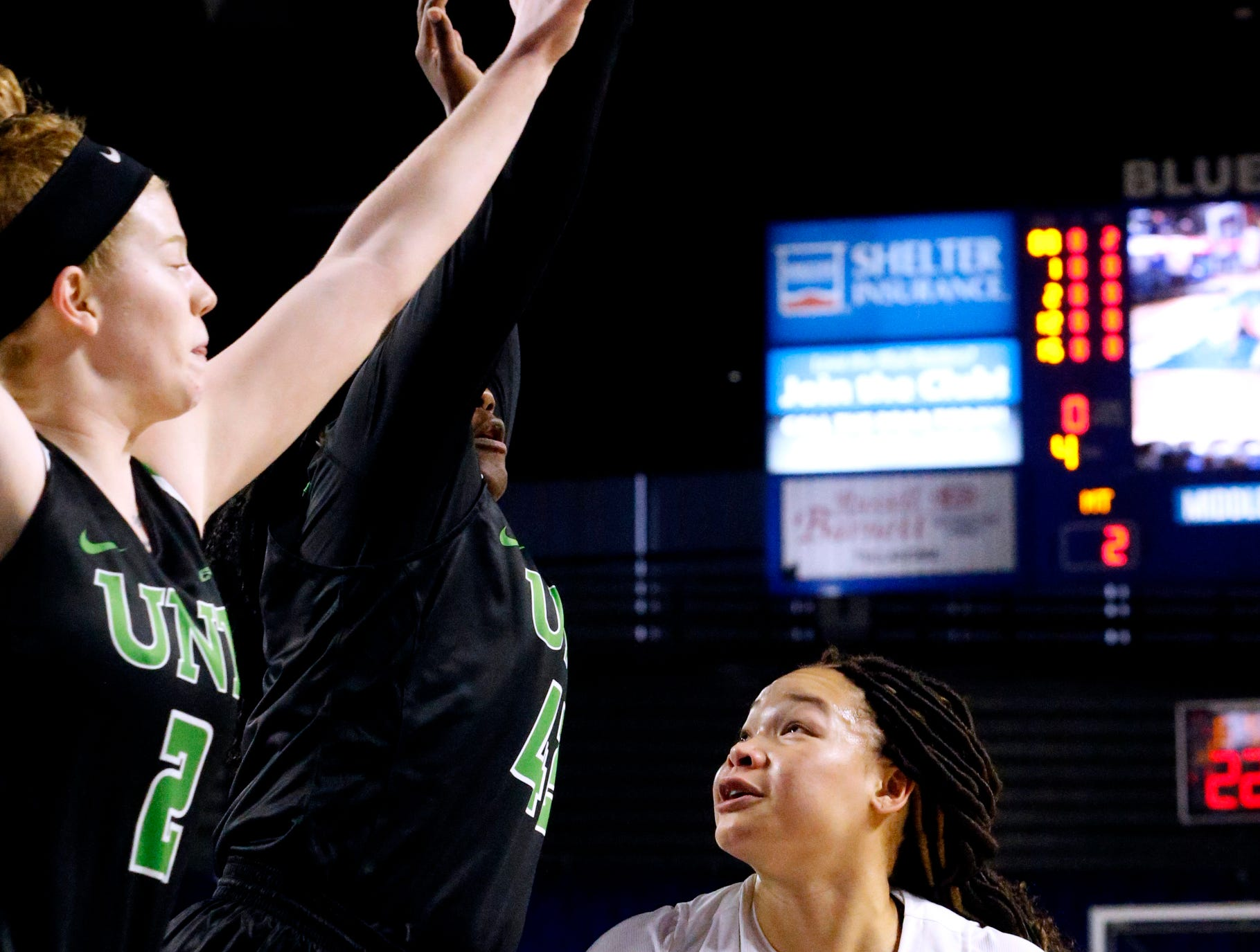 MTSU's forward Alex Johnson (00) goes looks to go up for a shot as North Texas' forward/center Anisha George (42) and North Texas' guard Grace Goodhart (2) guard her on Saturday Jan. 26, 2019.