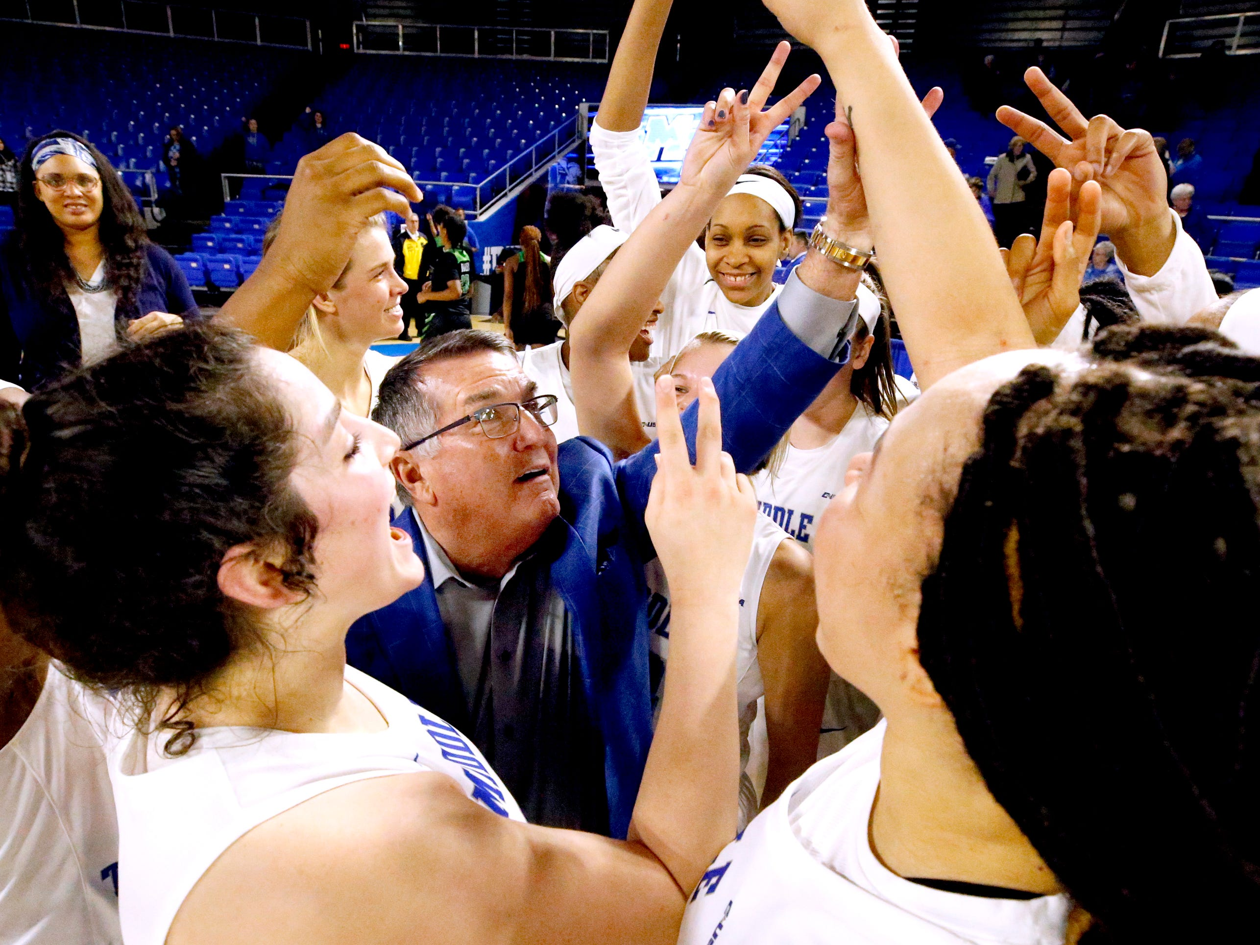 MTSU's head coach Rick Insell cheers with his team as after MTSU beat North Texas 61-46 and making him the all-time winningest coach in MTSU basketball history on Saturday Jan. 26, 2019.