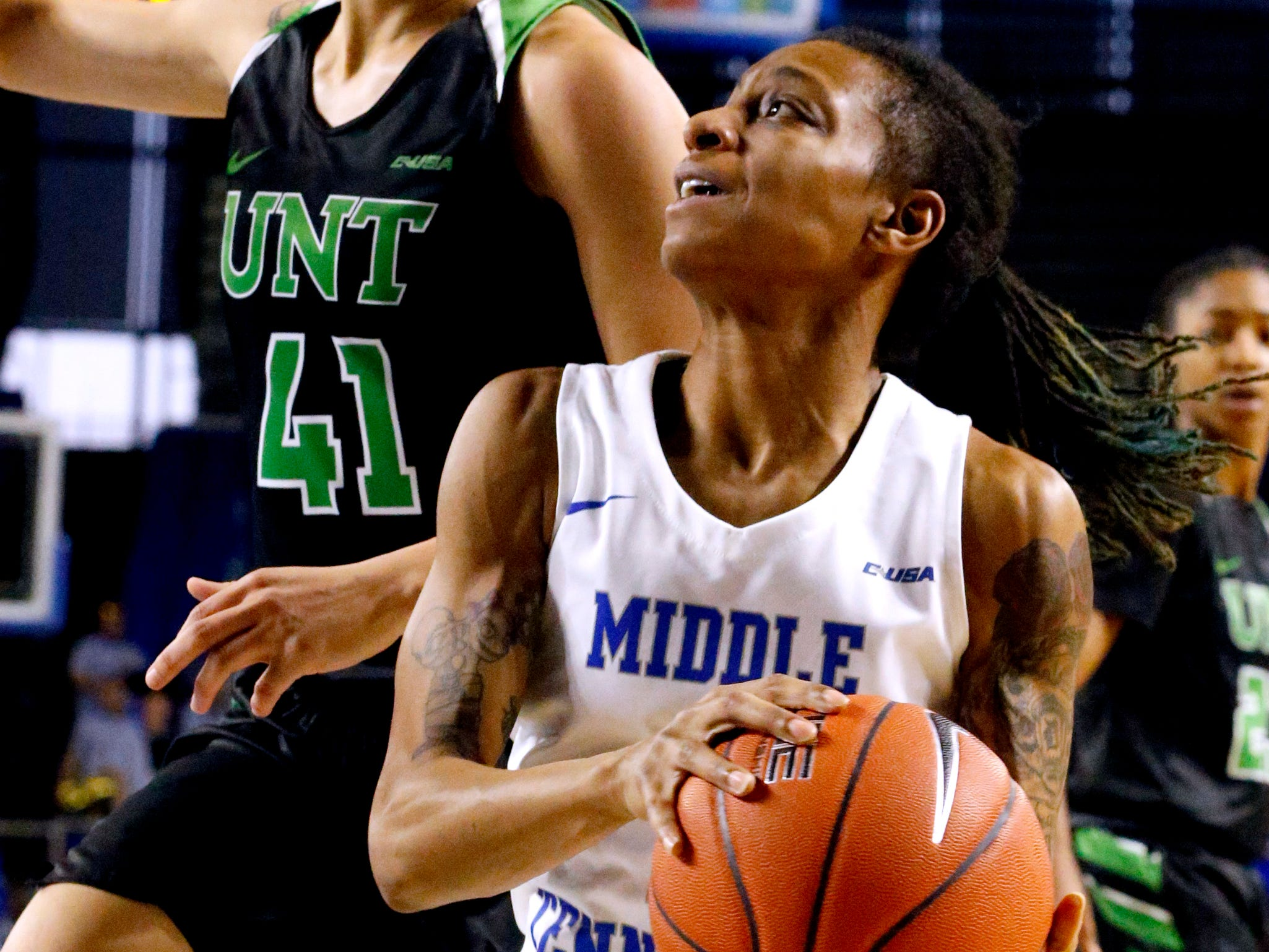 MTSU's guard A'Queen Hayes (1) goes up for a shot as North Texas' forward Madison Townley (41) guards her on Saturday Jan. 26, 2019.