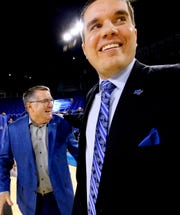 MTSU's head coach Rick Insell, left is congratulated by his son and assistant coach Matt Insell,right after Rick Insell won his 333rd game at MTSU making him the all-time winningest coach in the MTSU basketball program on Saturday Jan. 26, 2019.