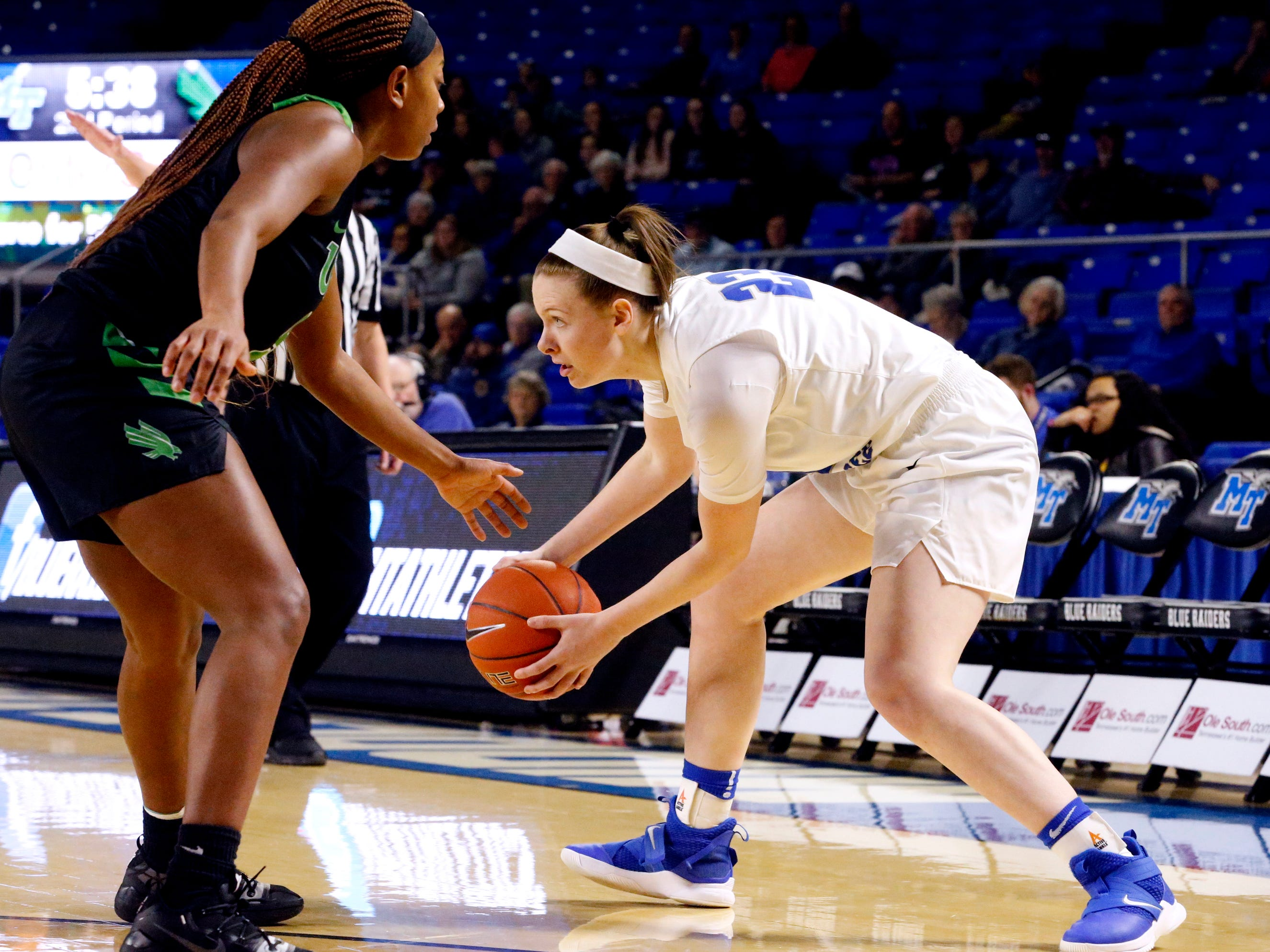 MTSU's guard Alexis Whittington (23) looks for a player t pass to as North Texas' guard Velma Mitchell (5) guards her on Saturday Jan. 26, 2019.