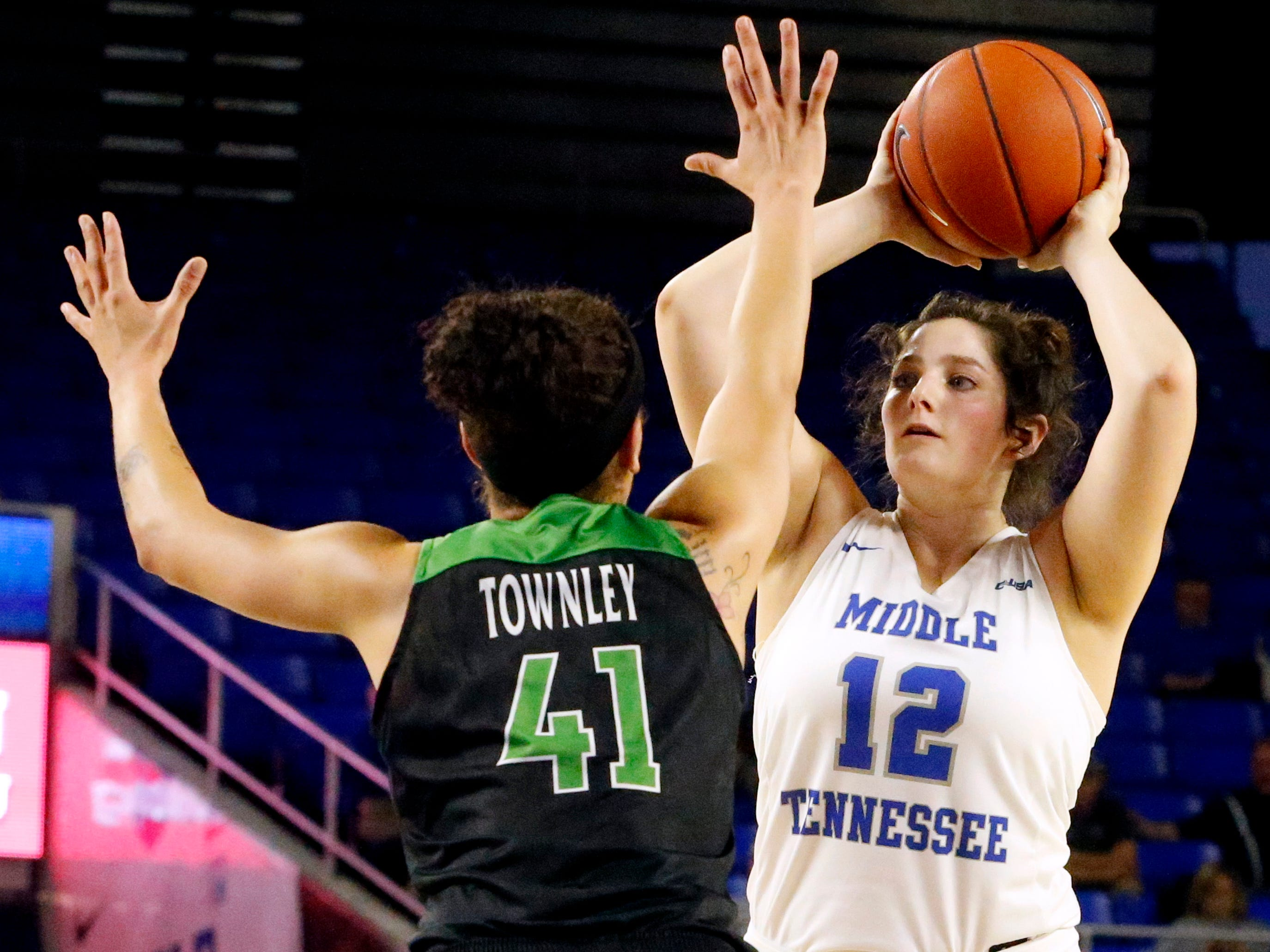 MTSU's guard Jess Louro (12) looks for a player to pass to as North Texas' forward Madison Townley (41) guards her on Saturday Jan. 26, 2019.