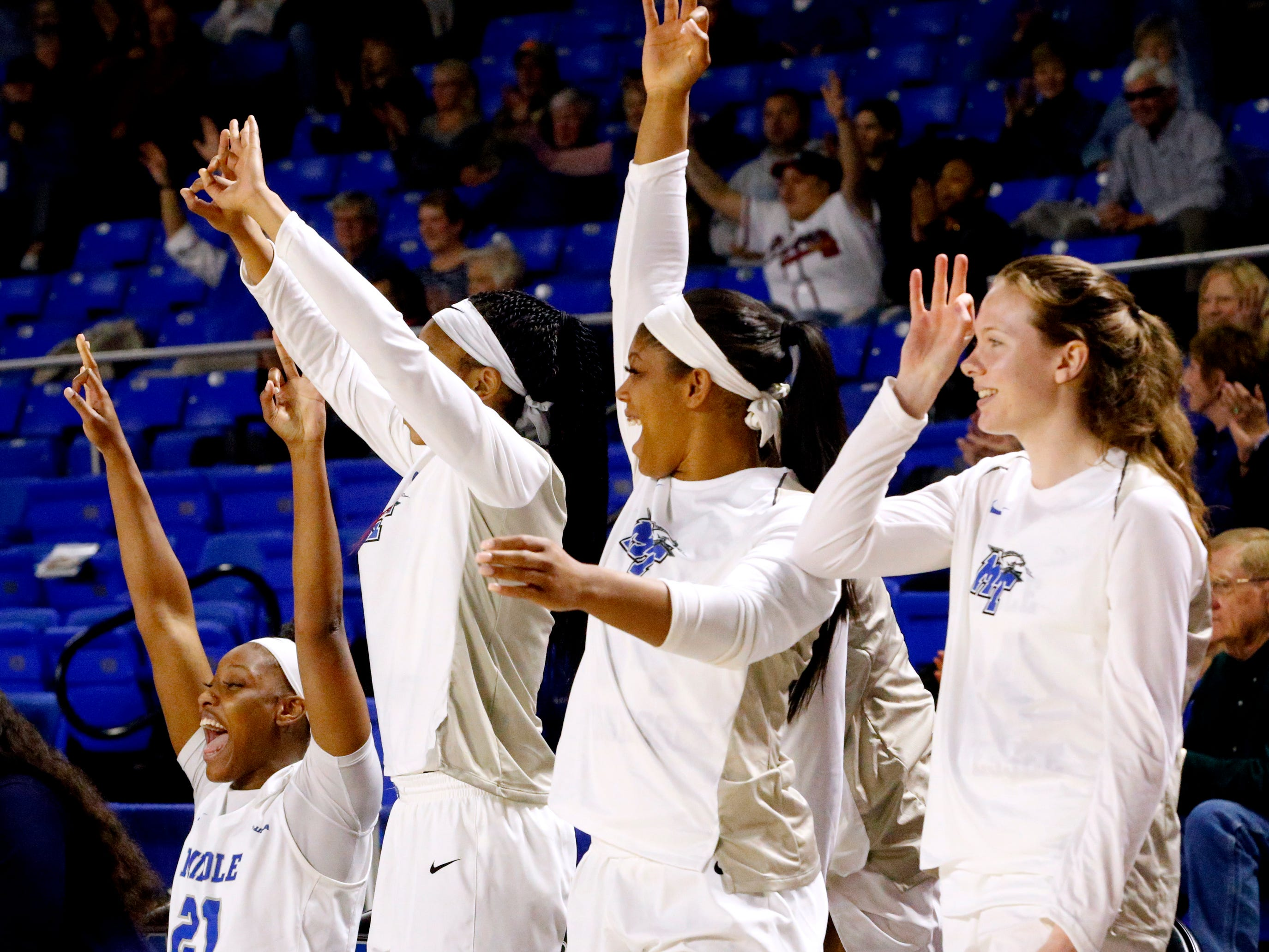 MTSU's bench celebrates as MTSU's guard Anna Jones (15) shoots a scores a three point basket on Saturday Jan. 26, 2019.