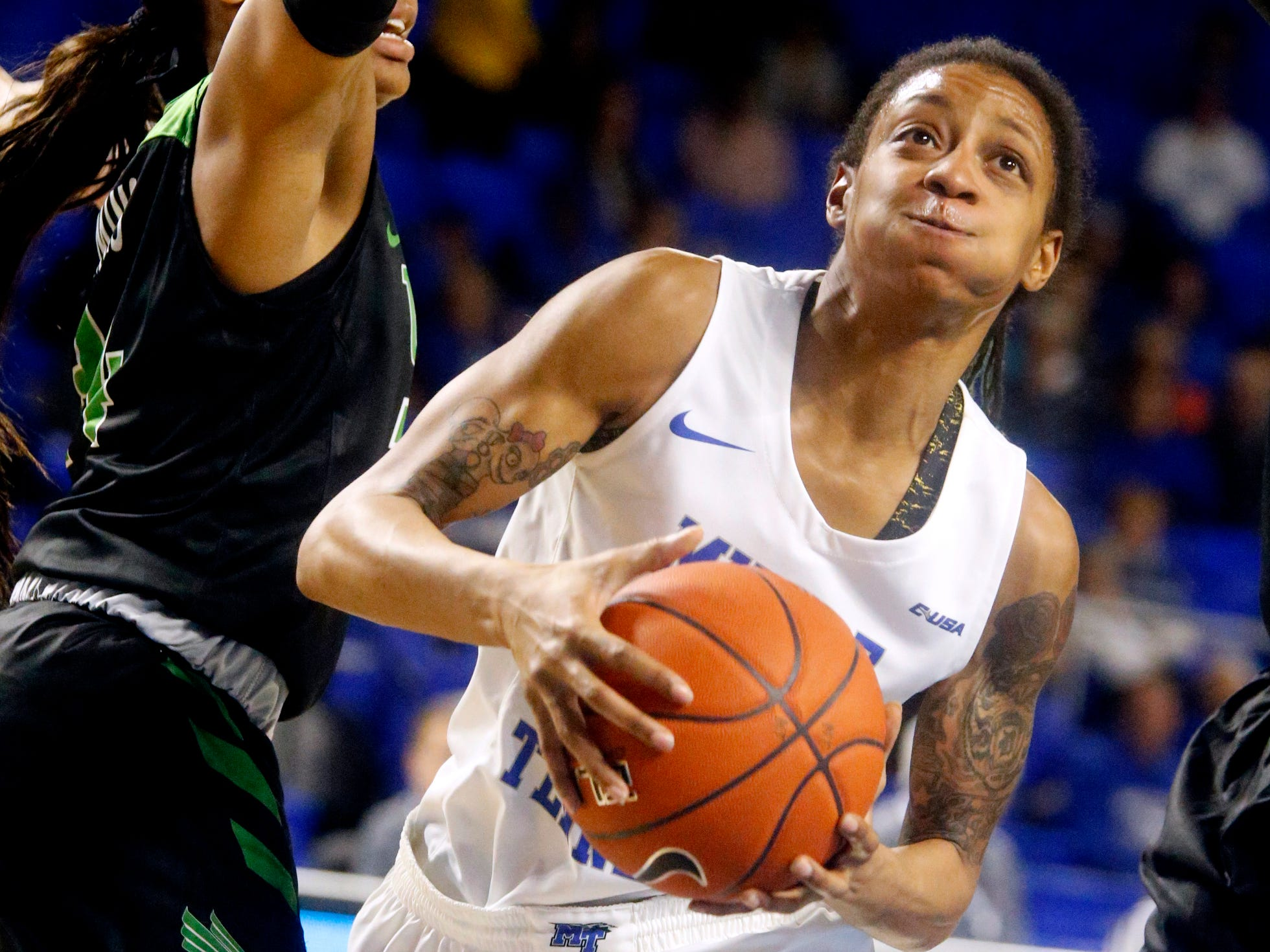 MTSU's guard A'Queen Hayes (1) moves around 