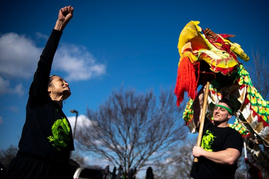 "Jen-Jen Lin, left, director of the Chinese Arts Alliance of Nashville, and Julian Buchi-Fotre, cheer ""Happy New Year"" while rehearsing the Chinese dragon dance outside Eakin Elementary School on Jan. 27, 2019."