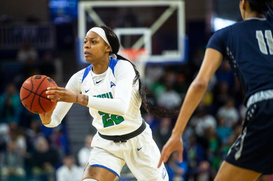 Florida Gulf Coast University's Destiny Washington looks to pass during a game against University of North Florida at Alico Arena on Sunday.