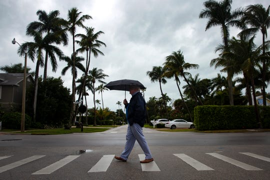 Bob McCusker, a seasonal Naples resident, walks along Second Street South on Sunday, Jan. 27, 2019, in downtown Naples.