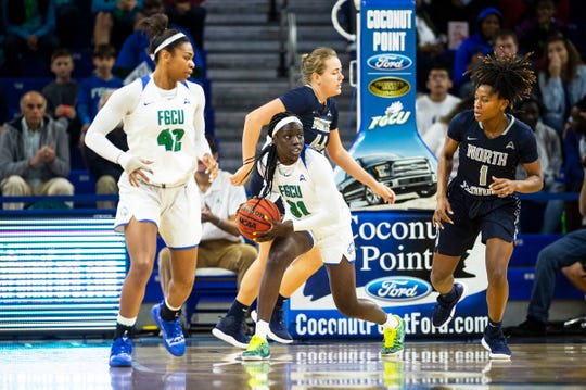 Florida Gulf Coast University's Nasrin Ulel brings the ball upcourt during a game against University of North Florida at Alico Arena on Sunday.