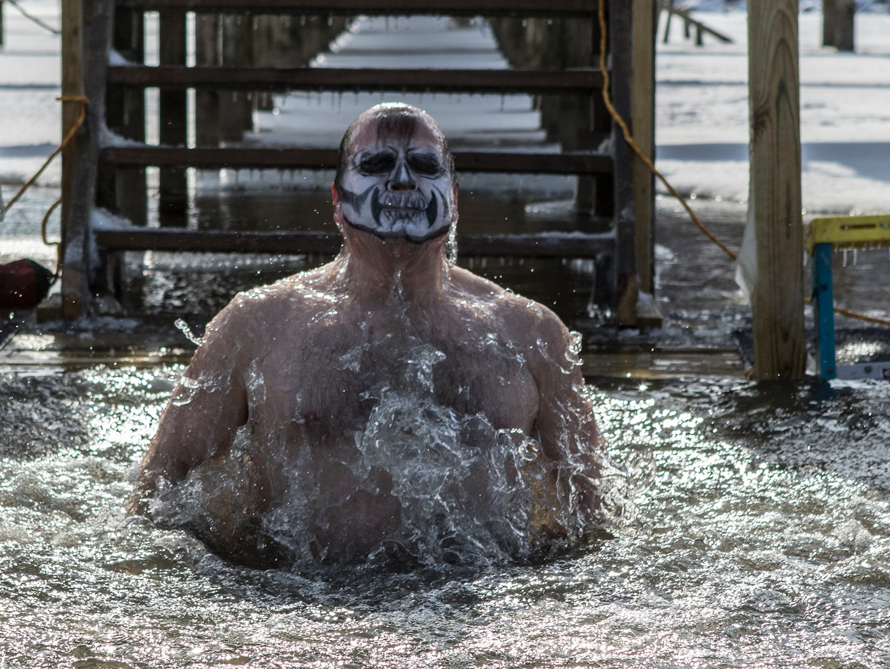 Ron Gillespie of Bexley, emerges from the water at Buckeye Lake after jumping in Sunday in 20 degree weather. Before jumping Gillespie shouted out this was the dumbest thing he'd ever done. Around 20 people walked down the pier at Buckeye Lake Winery to jump into Buckeye Lake Sunday for the annual Polar Plunge.