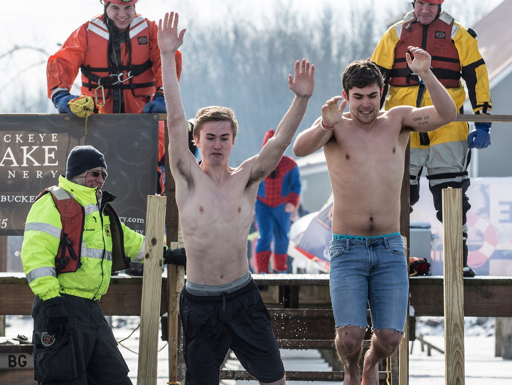 Around 20 people walked down the pier at Buckeye Lake Winery to jump into Buckeye Lake Sunday for the annual Polar Plunge. Crowds gathered on the lake around an opening cut into the ice to cheer on those brave enough top jump.