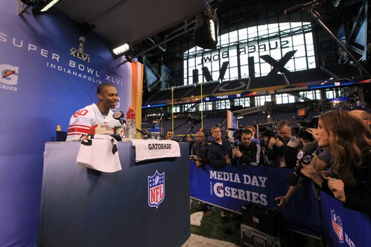 92596 -- Indianapolis, Indianapolis -- January 31, 2012 --- Super Bowl XLVI Media Day -- Giants wide receiver Victor Cruz being interviewed inside Lucas Oil Stadium.