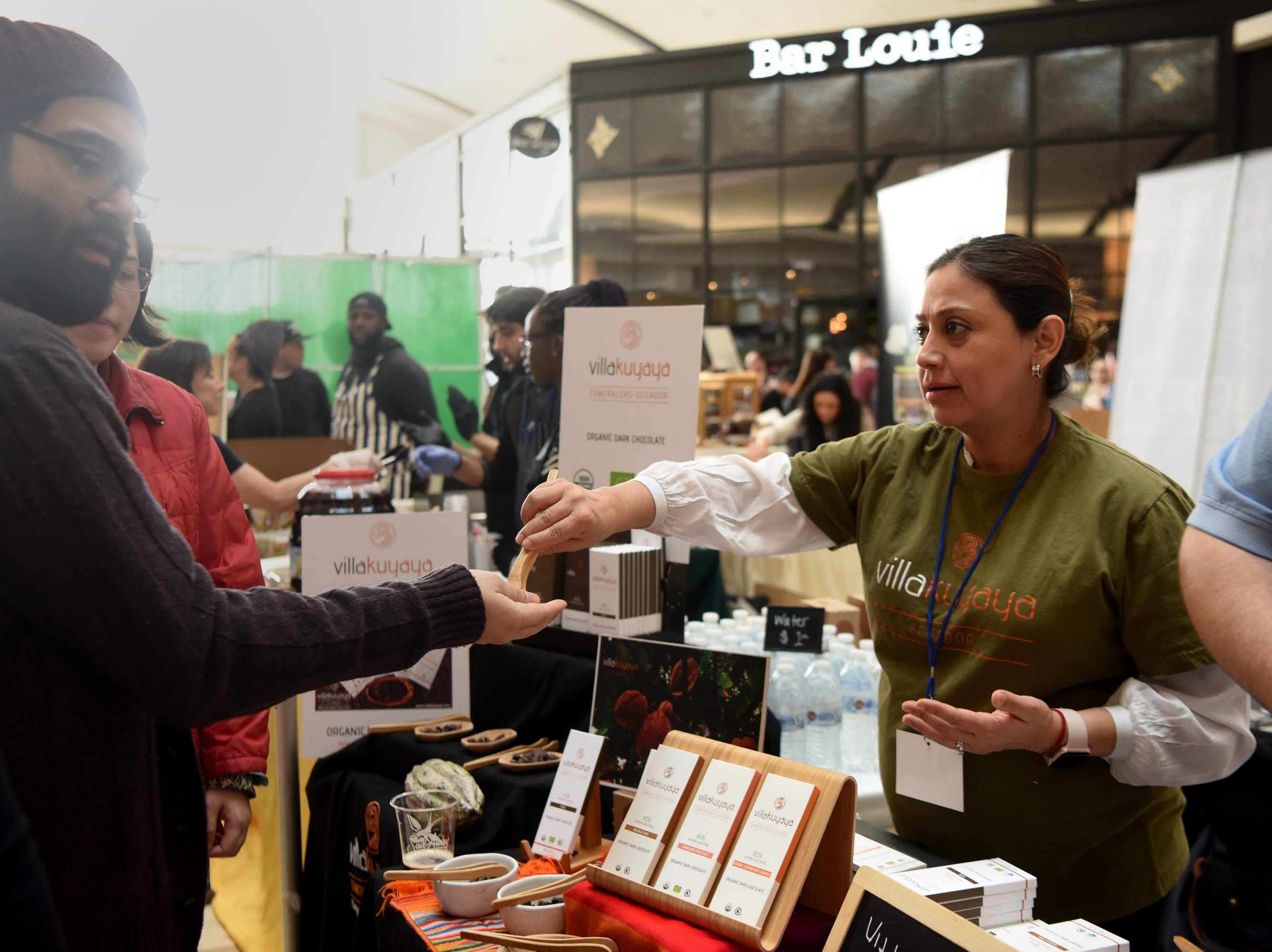 Tania Molina, founder of Villakuyaya Organic Dark Chocolate, offers samples of candy during the Chocolate Expo, held Sunday, January 27, 2019, at Westfield Garden State Plaza in Paramus.