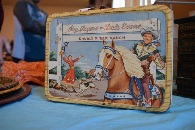 Featuring the immensely popular characters Roy Rogers and Dale Evans, this metal lunchbox was manufactured by Thermos in 1954 and came with an aluminum thermos. This lunchbox was one of Thermos' first forays into the market of character-licensed lunchboxes. It is said to be in response to Aladdin's release of the Hopalong Cassidy lunchbox. — Antiques Treasures Show at the Farm and Ranch Heritage Museum, Jan. 26, 2019.