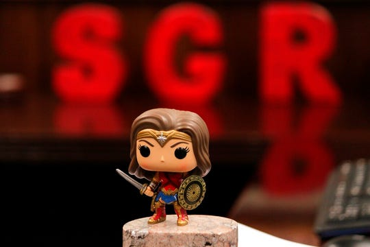 In this Wednesday, Jan. 16, 2019, photo, a Wonder Woman figurine sits at the edge of New Mexico Land Commissioner Stephanie Garcia Richard's desk in Santa Fe. A former educator and three-term state lawmaker, Garcia Richard is the first woman to serve as New Mexico's commissioner of public lands.
