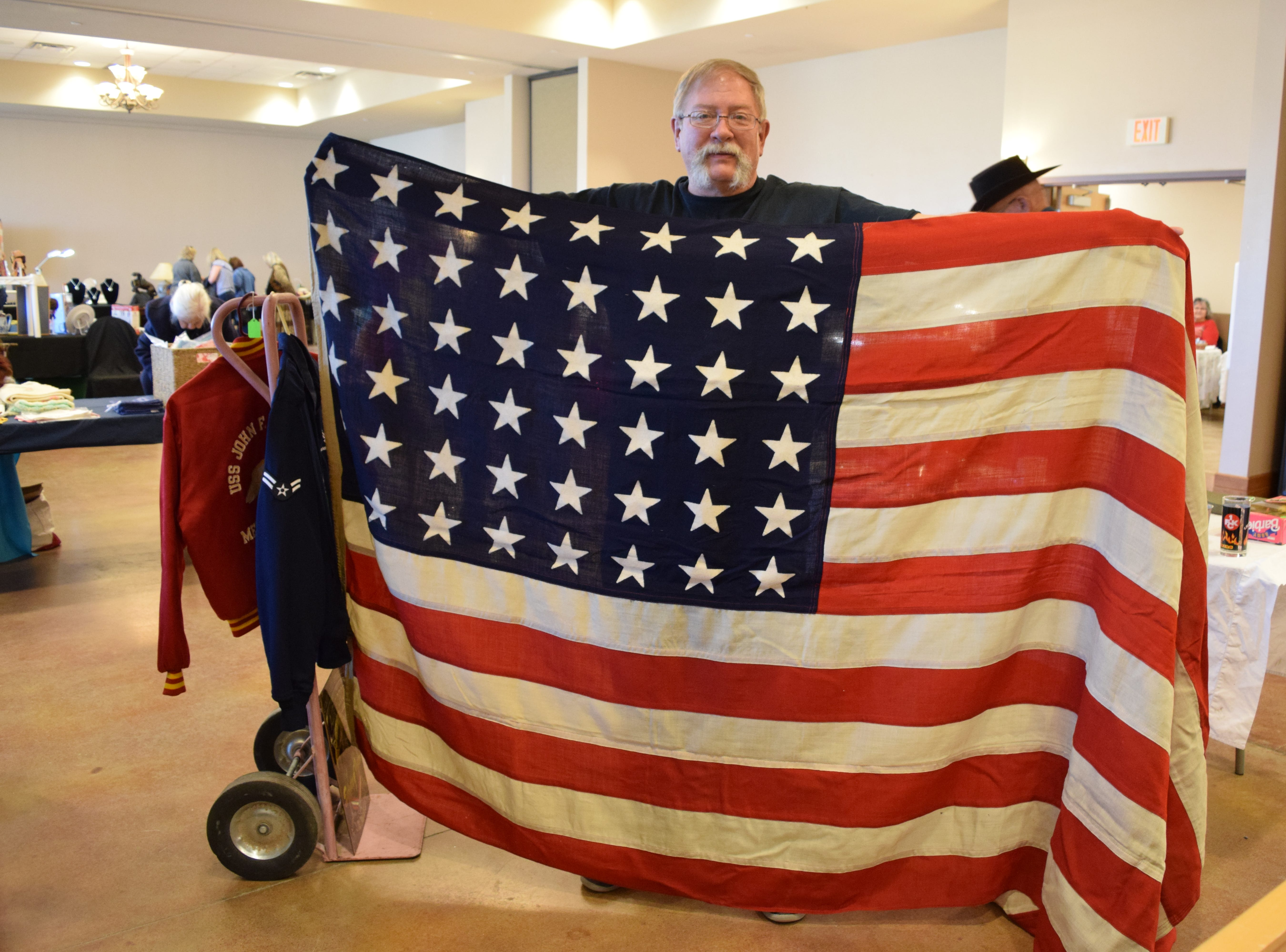 This flag, held by its current owner Kevin Dasing, flew on the USS New Orleans during the Battle of Leyte Gulf on Oct. 23-26, 1944. The Battle of Leyte Gulf (Philippines) is said by many to be the largest naval battle of World War II. During the battle, Japanese forces were crippled, allowing the U.S. invasion of the Philippines and reinforcing the Allies' control of the Pacific. — Antiques Treasures Show at the Farm and Ranch Heritage Museum, Jan. 26, 2019.