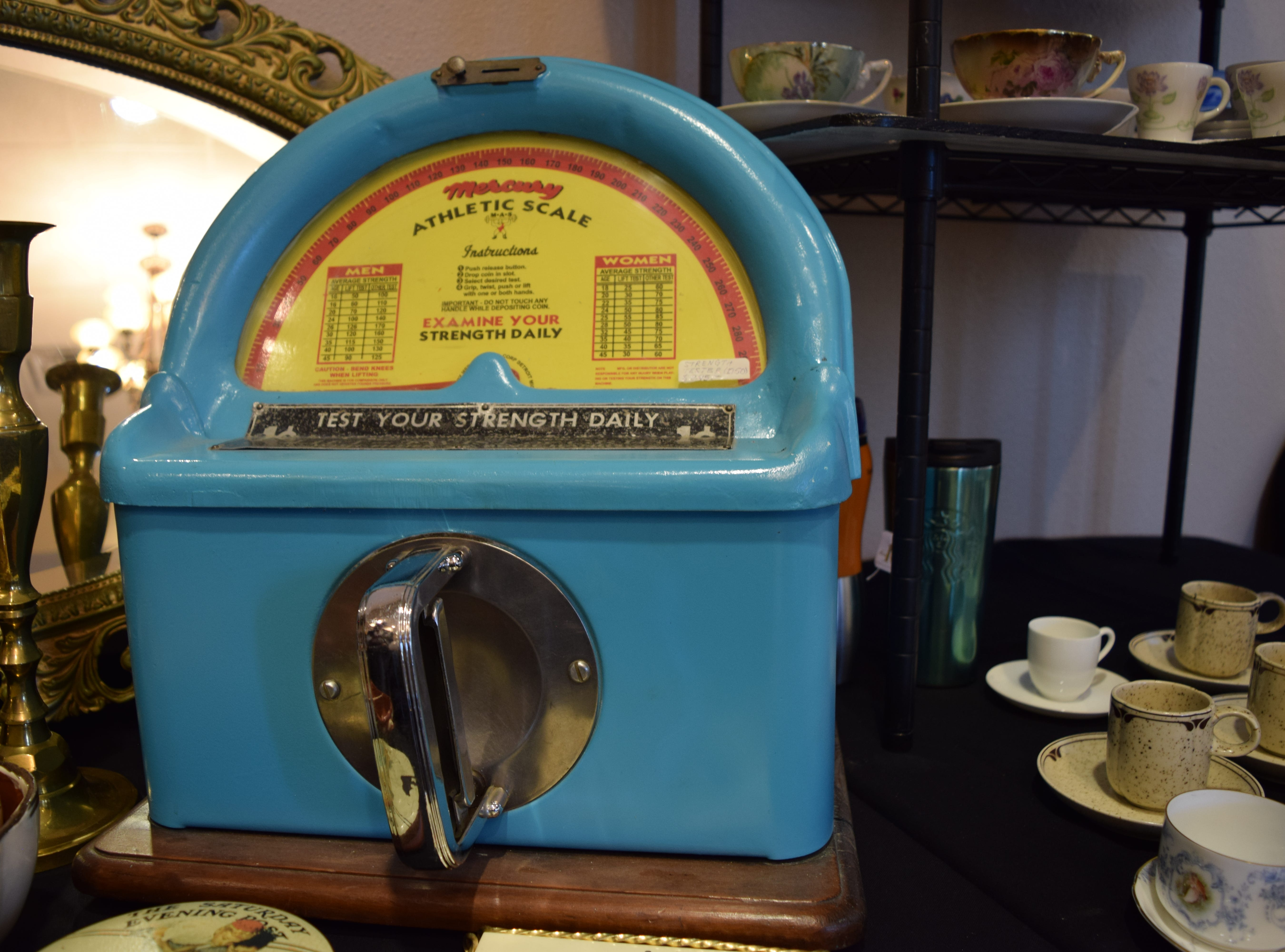 Often found in arcades across America in the 1950s were these coin-operated strength testers. This one, the Mercury Athletic Scale, was made by Great Lakes System starting in 1951. The machines needed only a penny to get started and then users could either lift, twist or grip the center handle to test their strength — Antiques Treasures Show at the Farm and Ranch Heritage Museum, Jan. 26, 2019.