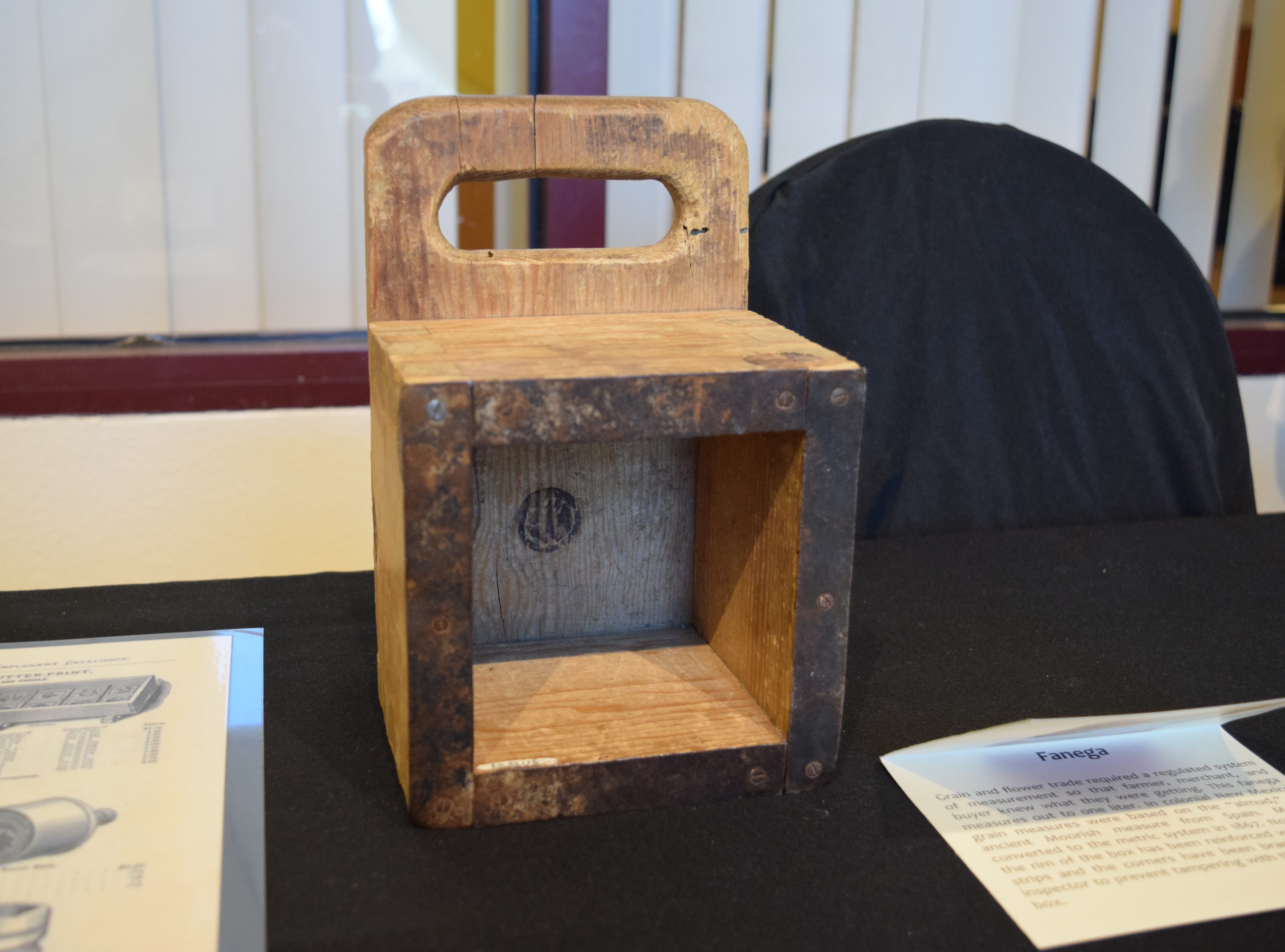 A tool for measuring, the fanega was an instrument used to help regulate grain and flour trade. This fanega measures out one liter for farmers, merchants and buyers. The rim of the box was reinforced with metal strips and the corners were branded by an inspector to prevent tampering. — Antiques Treasures Show at the Farm and Ranch Heritage Museum, Jan. 26, 2019.