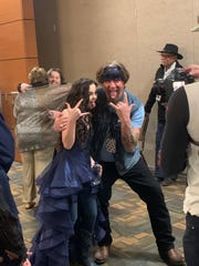 Chevel Shepherd and her father, Robert, mug for the cameras after her press conference Saturday before a free concert she gave at the Farmington Civic Center.