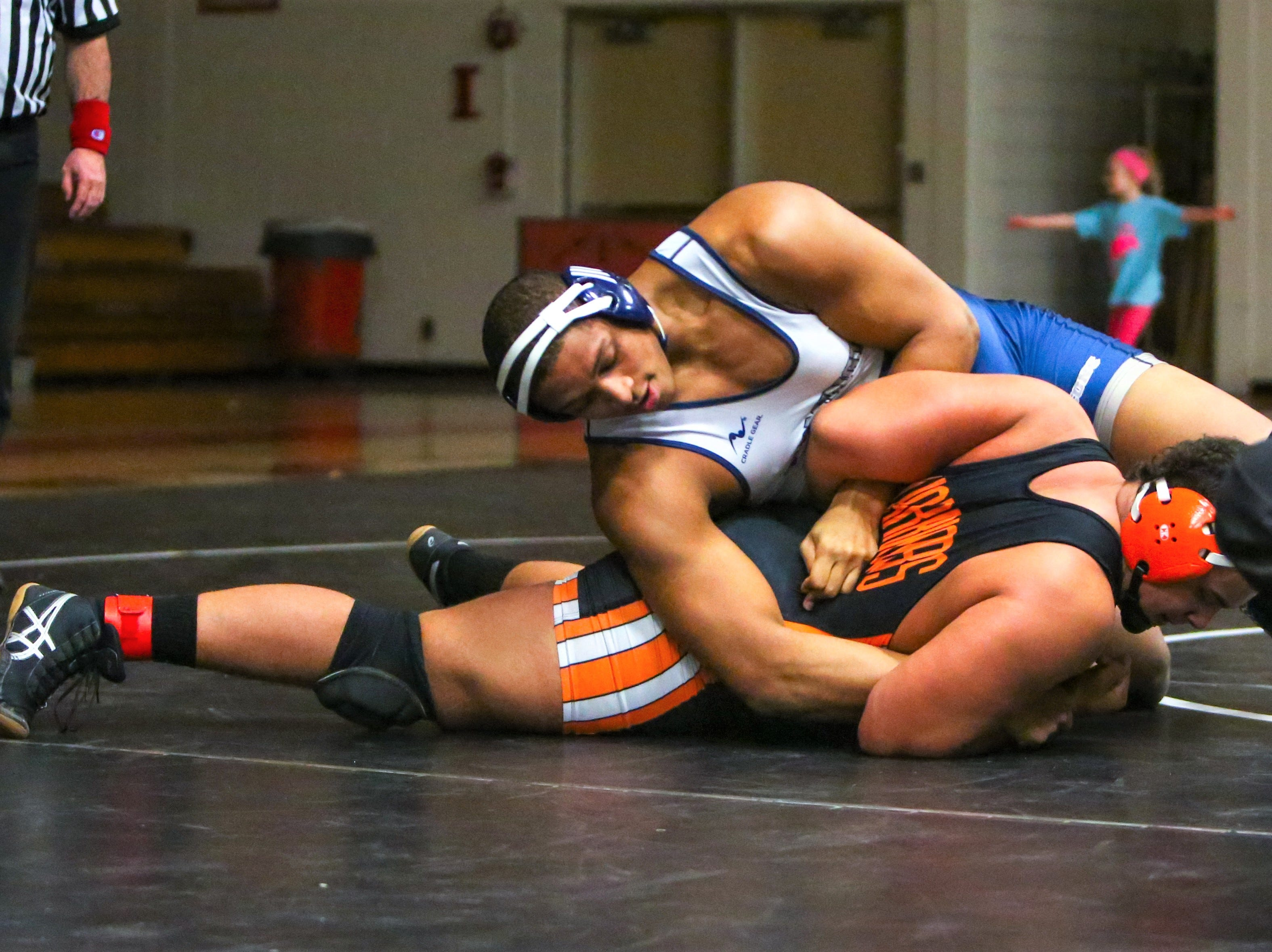 Farmington's Donovan King (top) takes control against Brother Rice's Daniel Jordan in the 285-pound final.