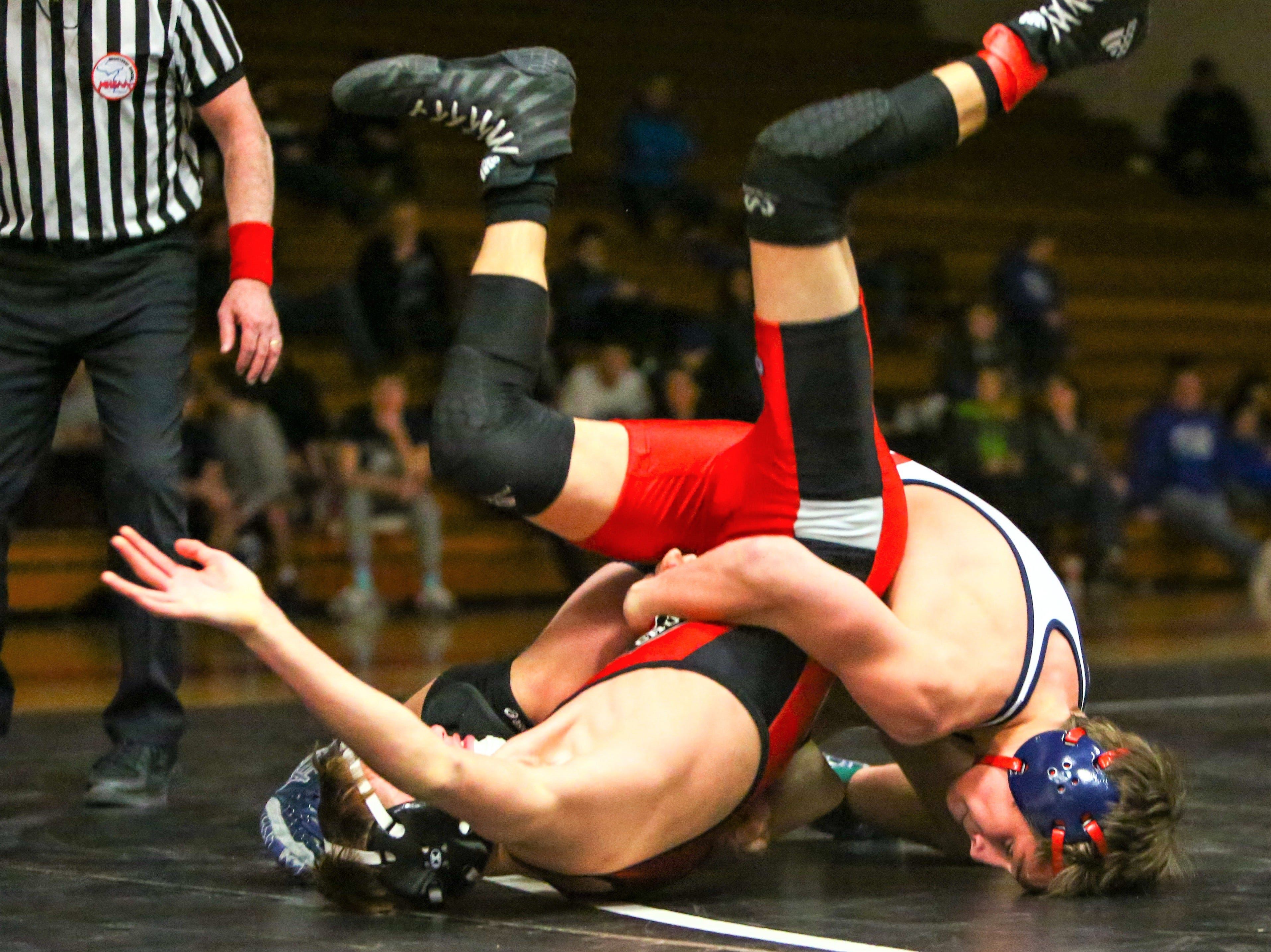 Franklin's Jager Kwiatkowski (right) took the 119-pound crown against Churchill's Aidan Haupt.