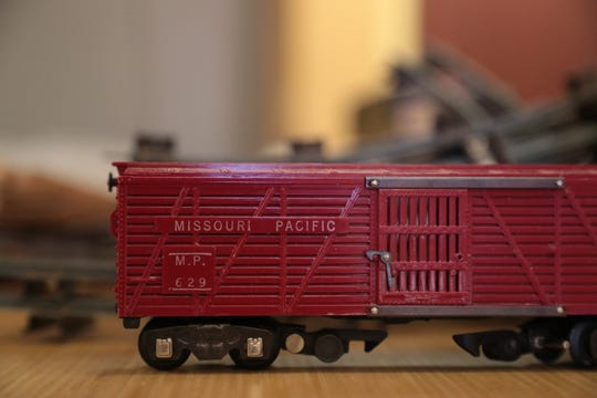Joel Magee appraises a train set at a vintage toy show in Palm Springs on Sunday.